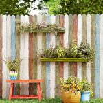 decorative gutter garden on fence